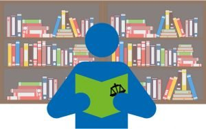 Person standing, having a a folder with a scale symbol on it, in his hands. In the background some shelves with many books on it. Altogether symbolizin a person taking care of the legal requirements and most importent documents for market access of medical software.